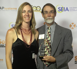 Jim and Laurel mug for the camera at the 2015 Solar Power World Top 500 Contractors Gala